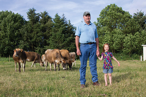 father and daughter on dairy