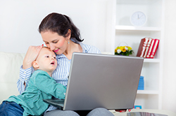 Mother working from home with a baby